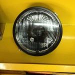 Mercedes Gelenda G-klasa lampa przednia dymiona z czarnym krzyżem w środku